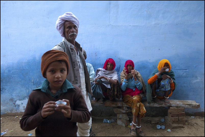 Pilgrims having a morning Chai during the Pushkar mela .