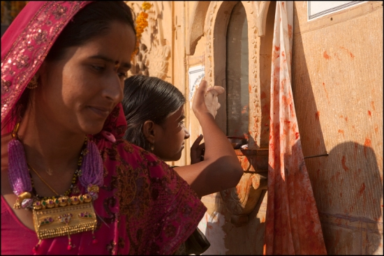 "Applying a ""tika"" on her forehead in a temple of Jaisalmer"