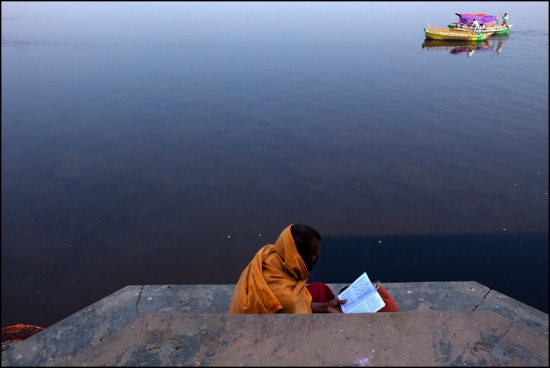 Reading sacred text on the bank of the Yamuna in Vrindavan