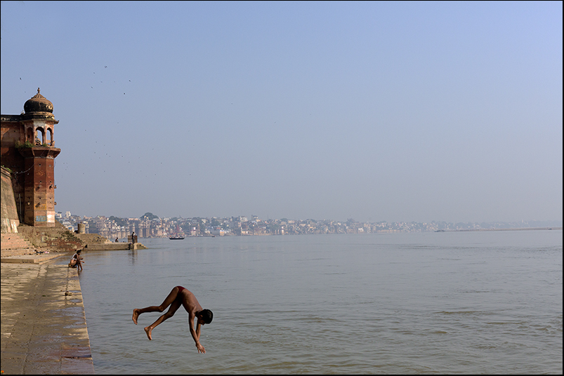 Kids diving in the sacred Ganges. Varanasi.